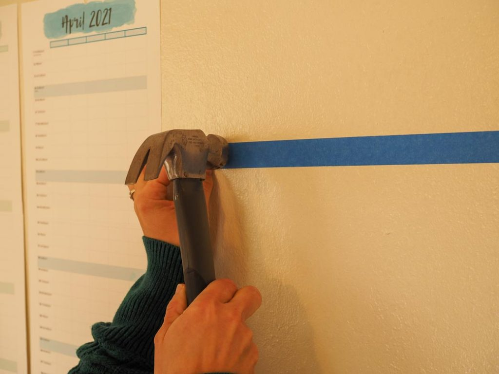 stick tape on wall