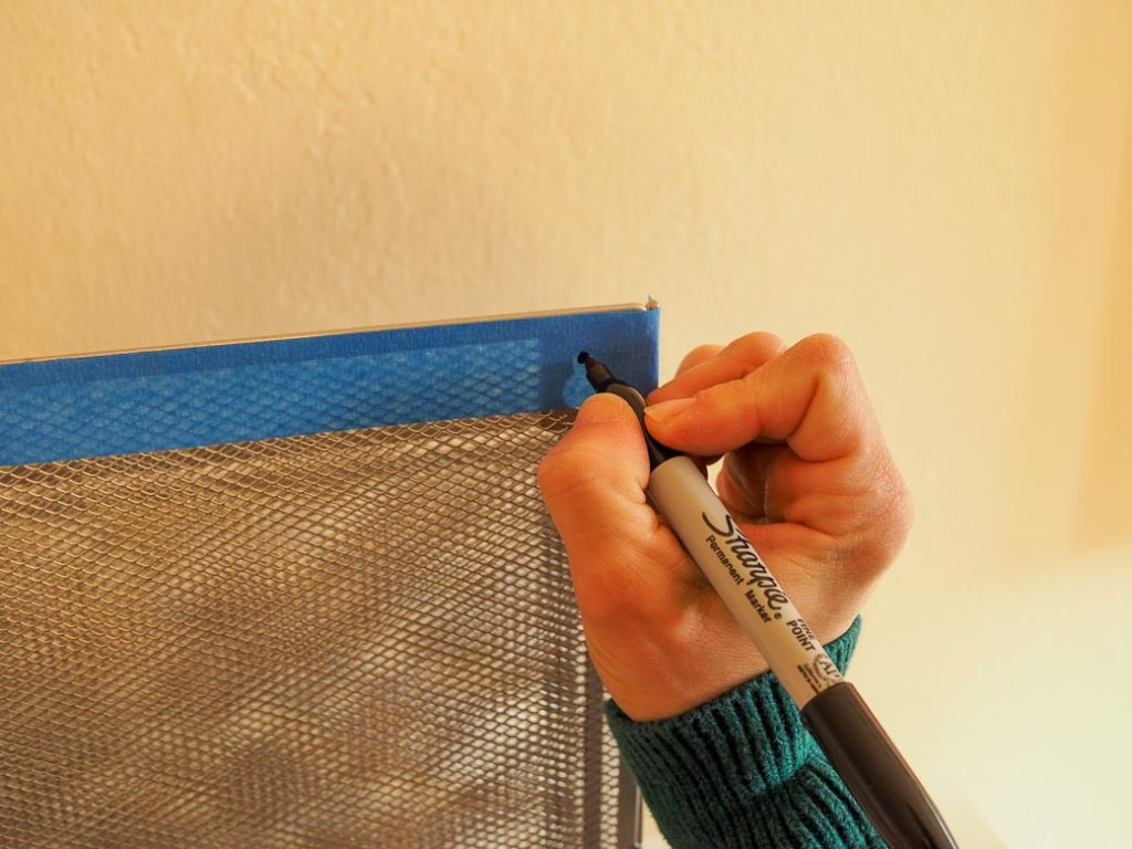 make holes with painters tape