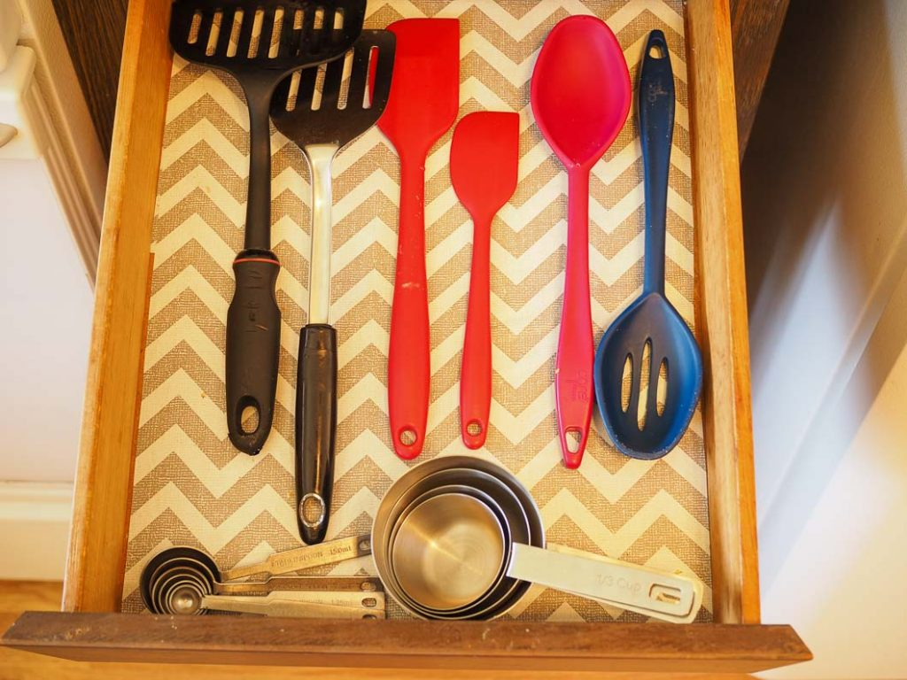 open utensil draw with removed duplicates for a more minimalist kitchen