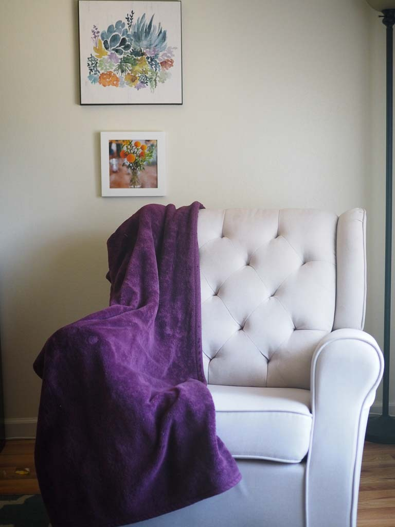 chair with a purple blanket on it for a living room cleaning checklist