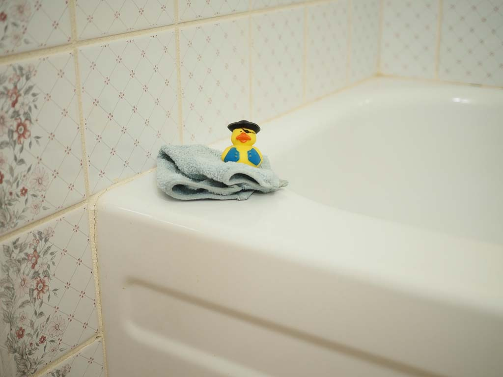 rubber ducky on a white bathtub