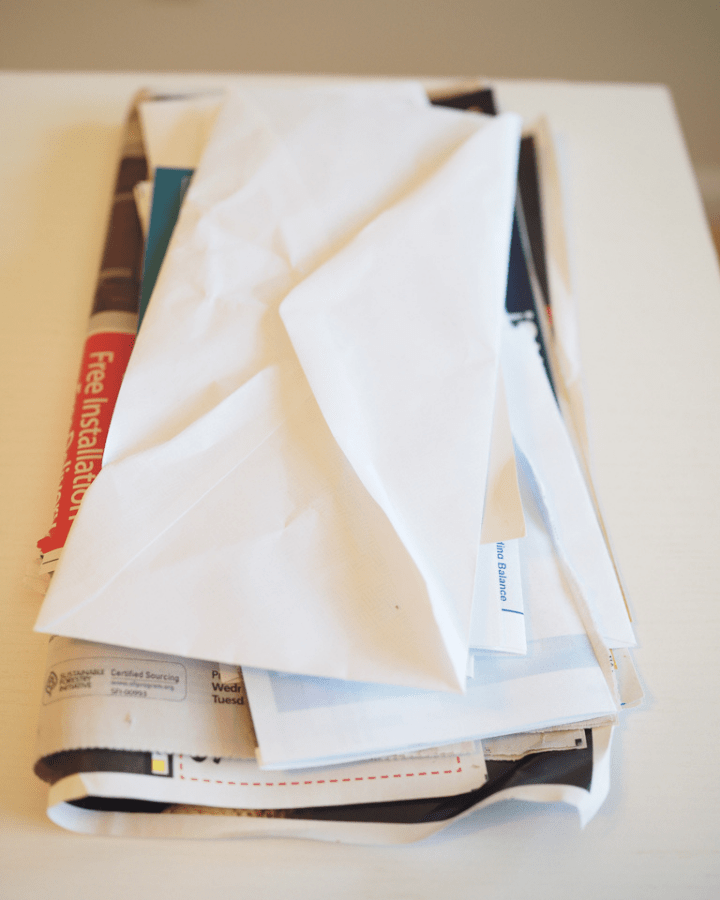 pile of mail on a counter