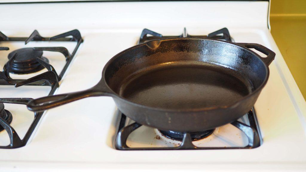 black cast-iron pan on white stove