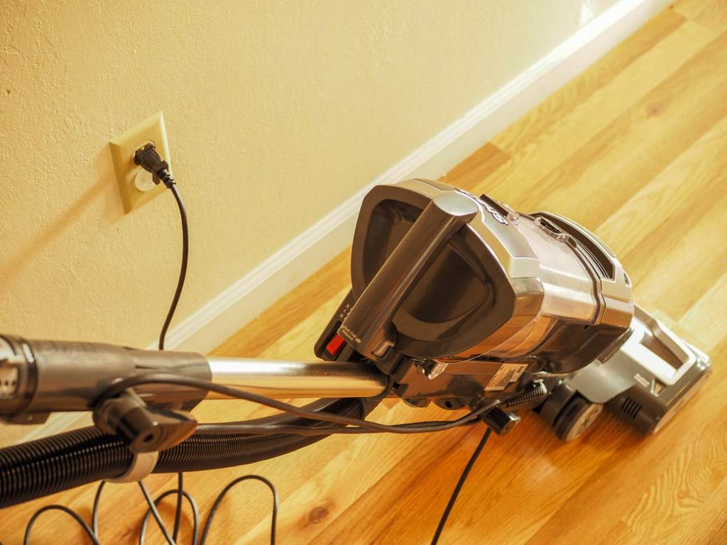 someone vacuuming the floor