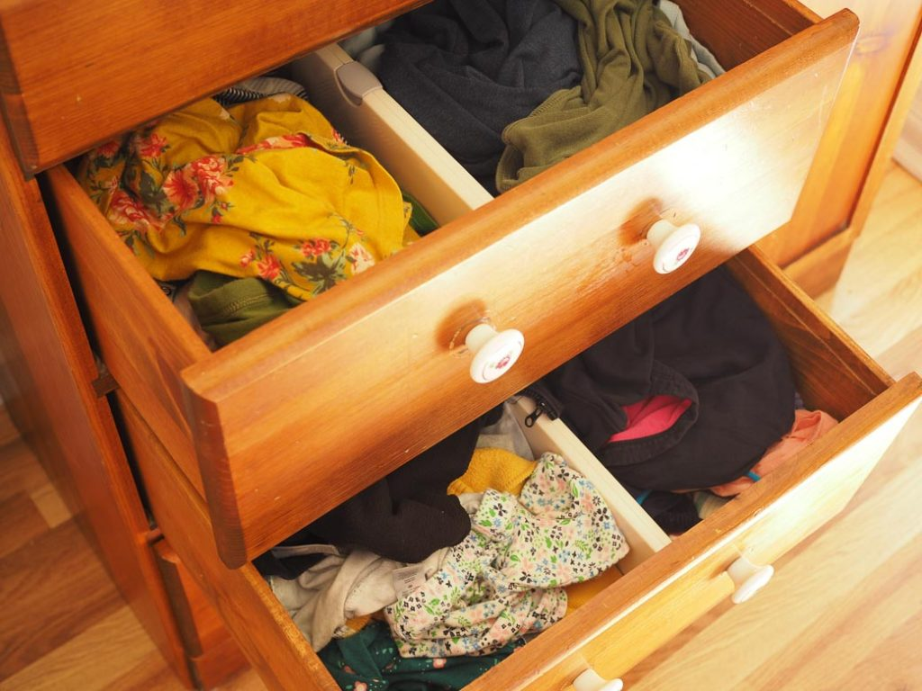 image of unfolded clothes in a dresser