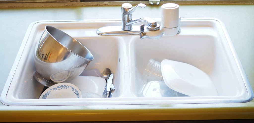 white sink with dirty dishes