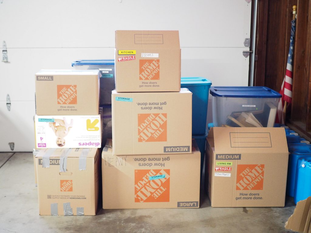 packed brown moving boxes for a moving tip and trick