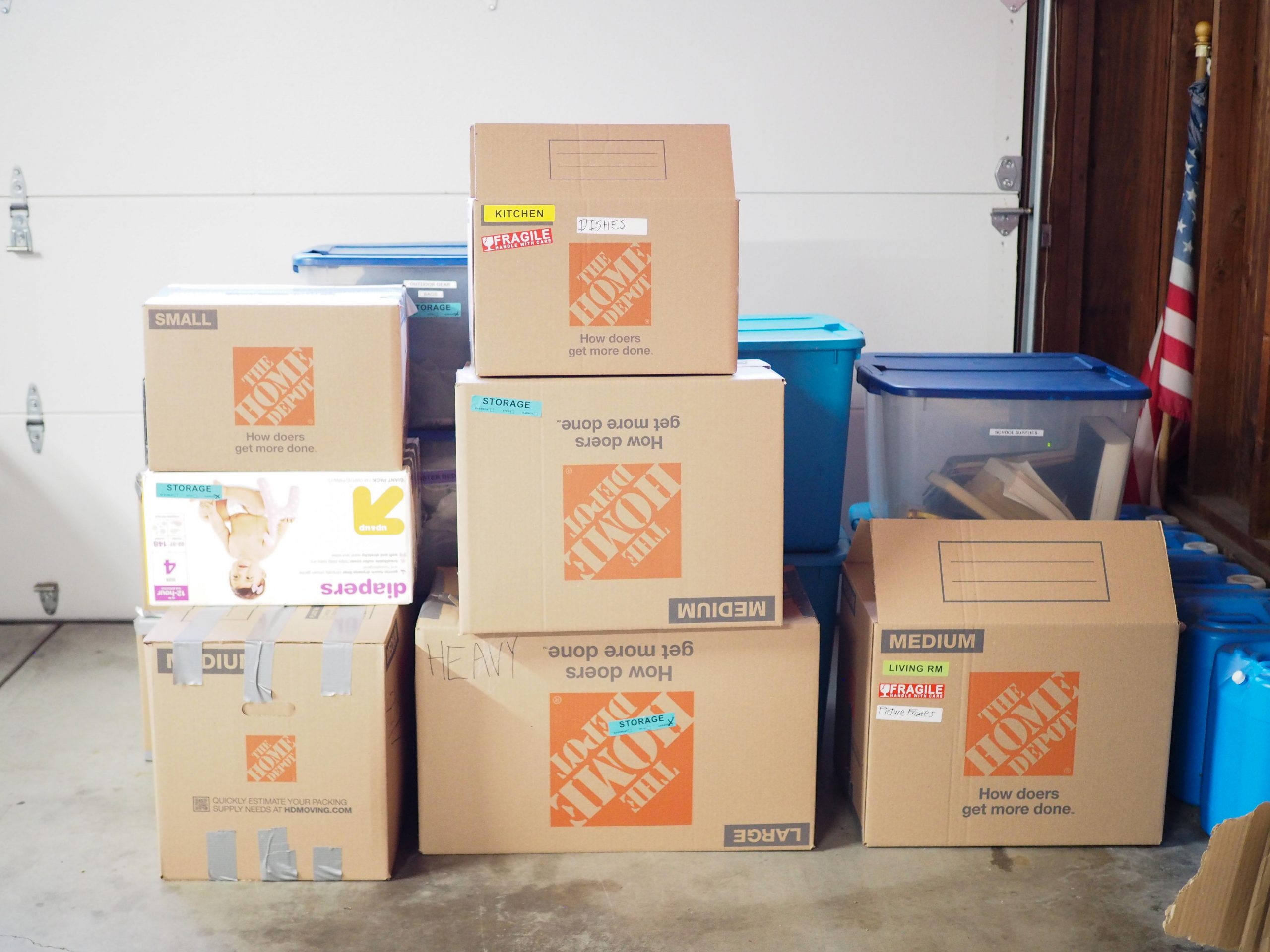 stacks of  brown moving boxes
