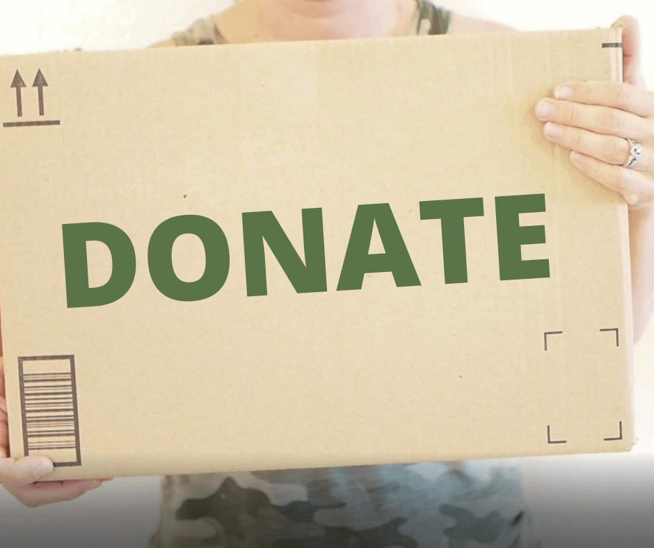 women holding a brown donation box