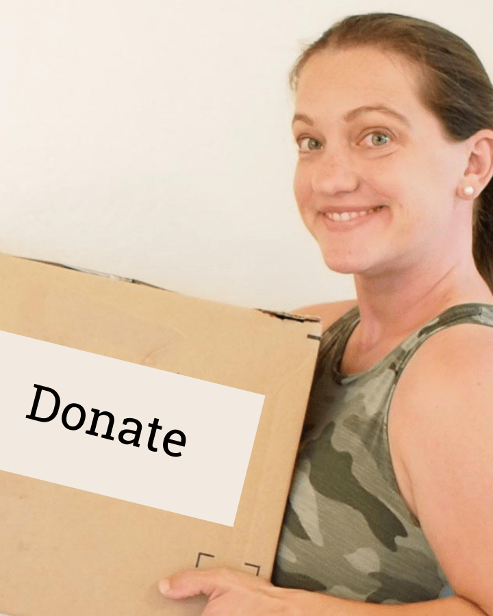 women holding a brown donate box