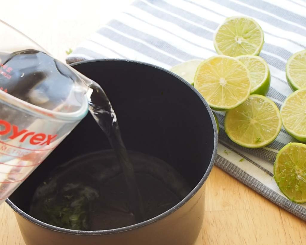 pouring water into a honey, lime mixture