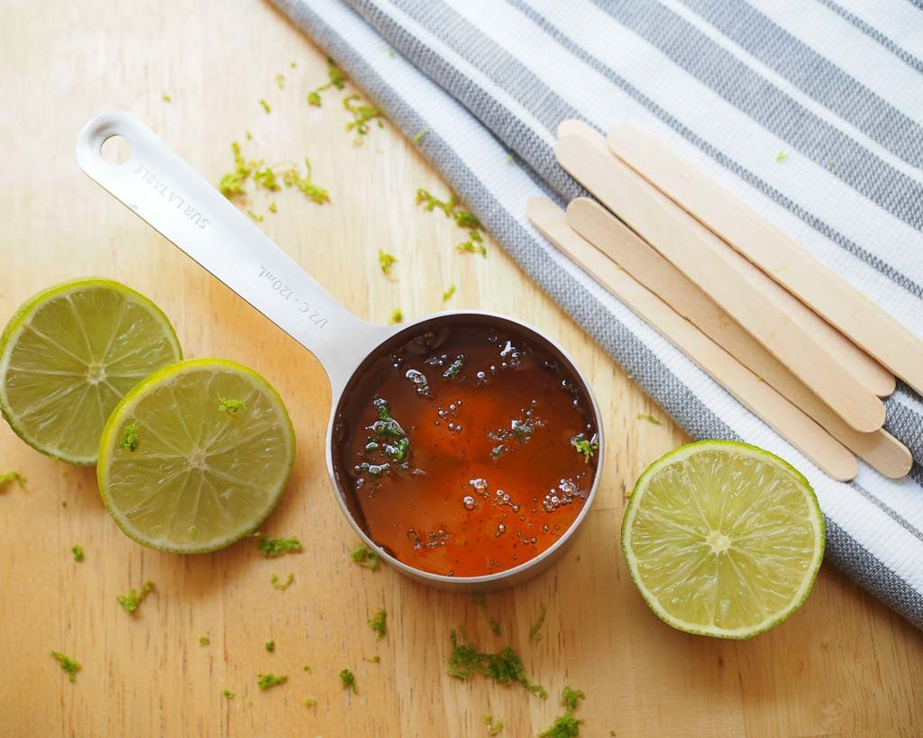 cut limes, with popsicles sticks, and 1/2 cup of honey